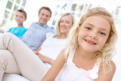 Buy stock photo A cute young girl sitting with her family outdoors