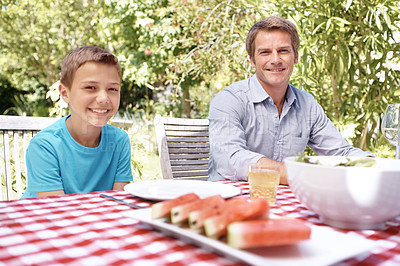 Buy stock photo Father and son sitting at a table outside getting ready to eat