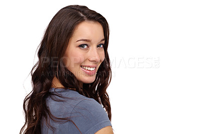 Buy stock photo Smiling young woman standing against a white background