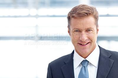 Buy stock photo Portrait of a mature businessman smiling alongside copyspace