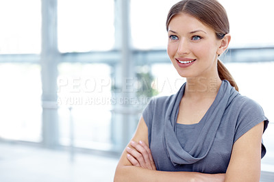 Buy stock photo A pretty young businesswoman crossing her arms and looking away thoughtfully