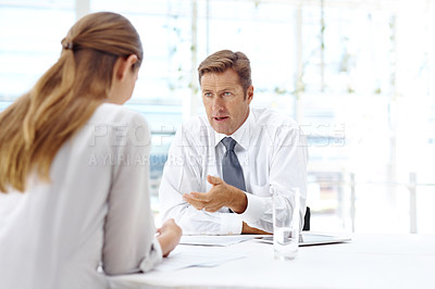 Buy stock photo A businessman explaining something to one of his colleagues