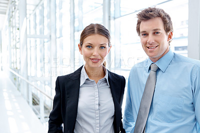Buy stock photo Two young businesspeople smiling while standing together