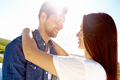Buy stock photo A happy affectionate couple standing outside