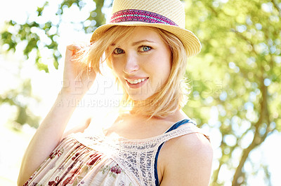 Buy stock photo Portrait of pretty smiling blonde posing with a hat in the park