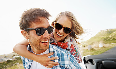 Buy stock photo A loving young couple enjoying the views while on a roadtrip
