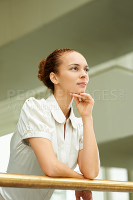 Buy stock photo Portrait of young businesswoman leaning on railing and looking away at copyspace