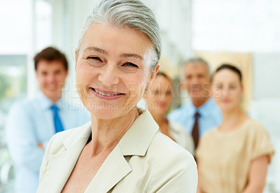 Buy stock photo Portrait of happy female executive smiling with her team in background