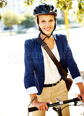 Buy stock photo A gorgeous young businesswoman riding her bicycle to work