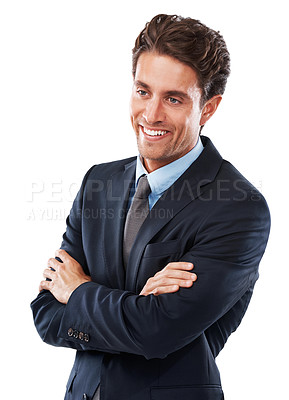 Buy stock photo A handsome young businessman standing with folded arms against a white background
