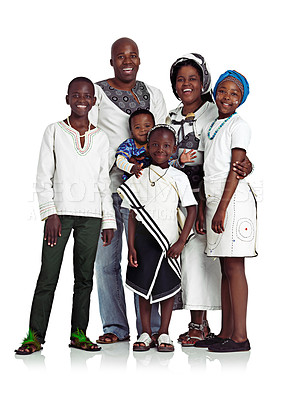 Buy stock photo Studio shot of a traditional african family smiling happily, isolated on white