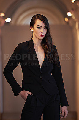 Buy stock photo Shot of an attractive and elegant young woman in a  luxurious setting