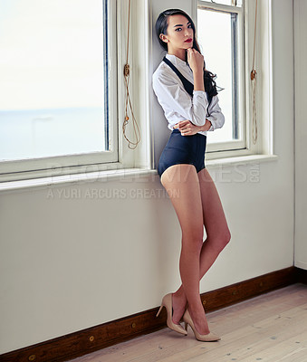 Buy stock photo Shot of an attractive young  posing in a sexy ensemble