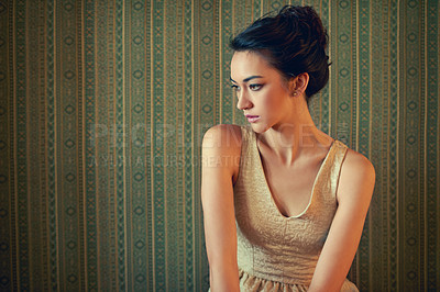 Buy stock photo Shot of a beautiful and elegant young woman posing in a green wallpapered room