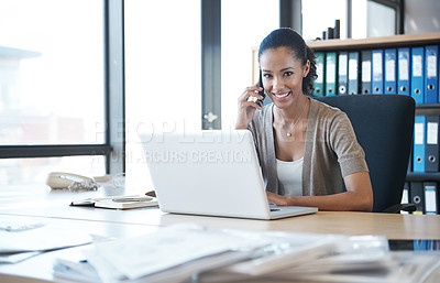Buy stock photo Portrait of a beautiful businesswoman using her mobile phone at her desk in a bright office space
