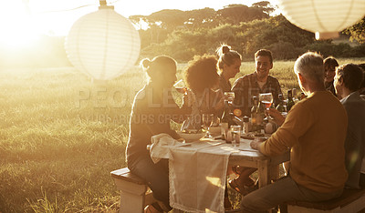Buy stock photo Cropped shot of a group of people eating and drinking outdoors