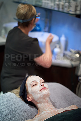 Buy stock photo Shot of a woman getting a facial treatment at a clinic