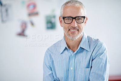 Buy stock photo Portrait of a handsome businessman in the office. The commercial designs displayed in this image represent a simulation of a real product and have been changed or altered enough by our team of retouching and design specialists so that they are free of any copyright infringements