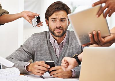 Buy stock photo A cropped shot of a handsome businessman with colleagues requesting various things from him