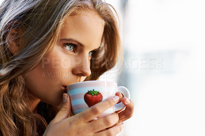 Buy stock photo Portrait of a beautiful teen holding a cup of coffee at a bistro
