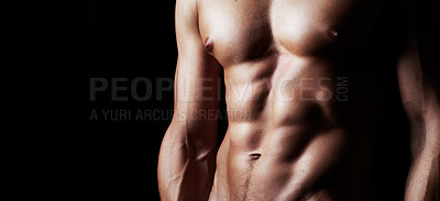 Buy stock photo Studio shot of a muscular shirtless man isolated on black