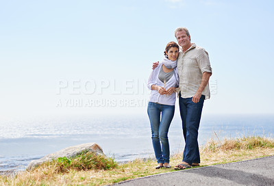 Buy stock photo A couple holding each other walking along the road