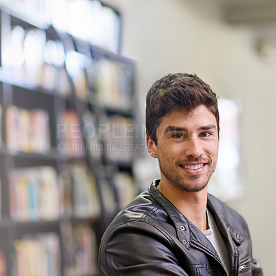 Buy stock photo Portrait of a handsome male student in a university library