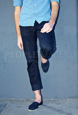 Buy stock photo Cropped shot of a man leaning against