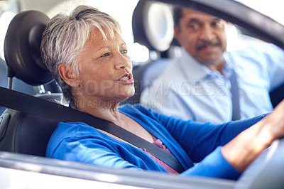 Buy stock photo Shot of a senior couple going for a drive together in a car