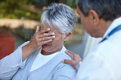 Buy stock photo Cropped shot of a senior woman getting some bad news from her doctor