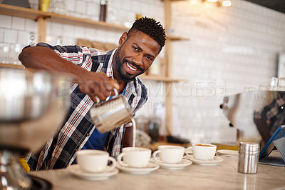 Buy stock photo Cropped portrait of a handsome male barista preparing coffee for his customers