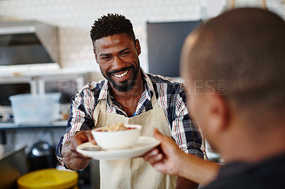 Buy stock photo Cropped shot of a young man serving a customer at a cafe