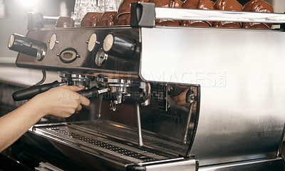Buy stock photo Cropped shot of a female barista making a cup of coffee