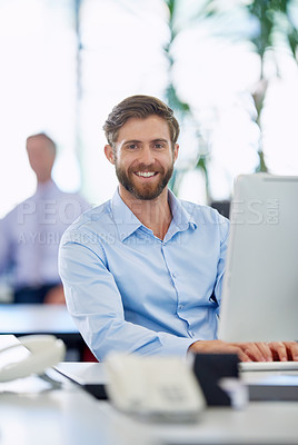 Buy stock photo Cropped shot of a handsome young businessman in the office