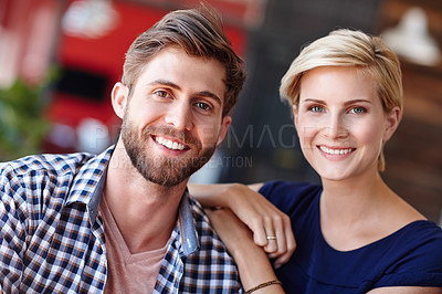 Buy stock photo Cropped portrait of two coworkers in an informal office setting