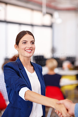 Buy stock photo Cropped shot of an attractive young businesswoman shaking a colleague's hand