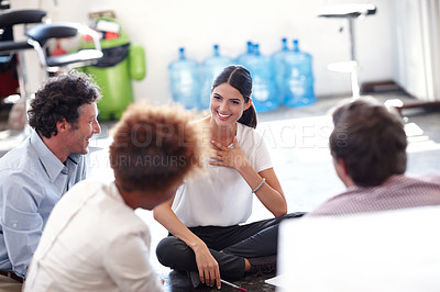 Buy stock photo Cropped shot of a group of designers having an informal office meeting