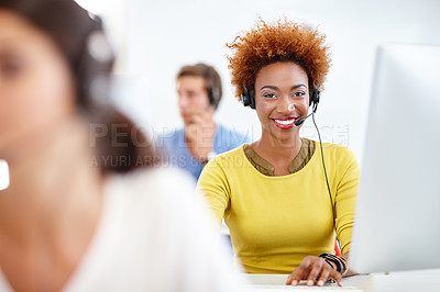 Buy stock photo Cropped shot of colleagues working in a call center