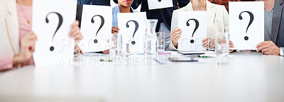 Buy stock photo Cropped shot of a group of businesspeople holding up cards with question marks on them