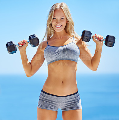 Buy stock photo Portrait of a beautiful young woman lifting weights outside