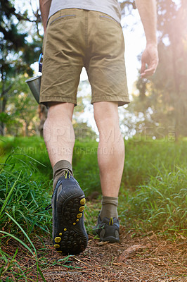 Buy stock photo Cropped shot of a hiker walking in the forest