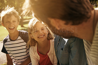 Buy stock photo Shot of a brother and sister with their parents at the park