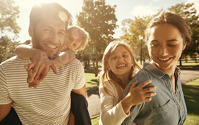 Buy stock photo Portrait of a family enjoying a sunny day at the park