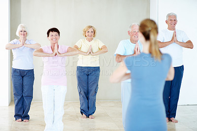 Buy stock photo A group of elderly people doing yoga together