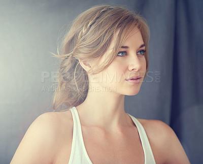 Buy stock photo Shot of a beautiful young woman looking thoughtful