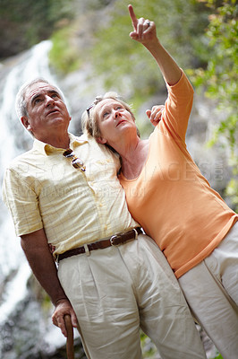 Buy stock photo An affectionate senior couple looking at the views while in nature