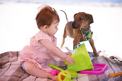 Buy stock photo Shot of an adorable little girl playing with her dog