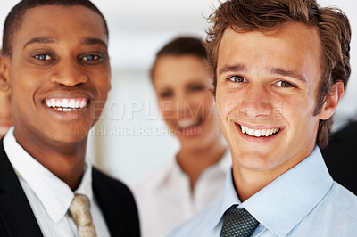 Buy stock photo Portrait of a happy young business male colleagues standing together at office