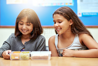 Buy stock photo Shot of young school children eating lunch at school