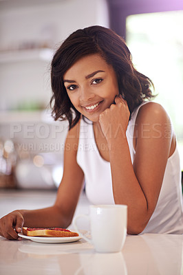 Buy stock photo Portrait of a young woman enjoying breakfast at home